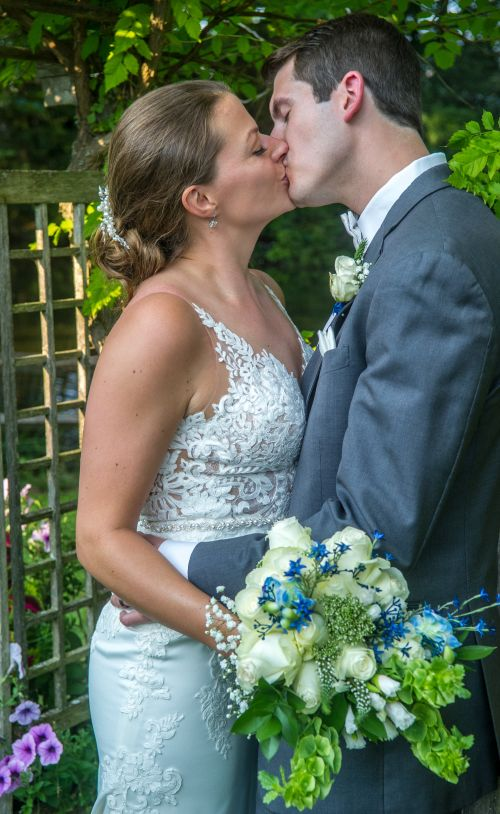 Wedding kiss mile away resteraunt courtyard marmot milford new hampshire wedding venue.  New england wedding photographer