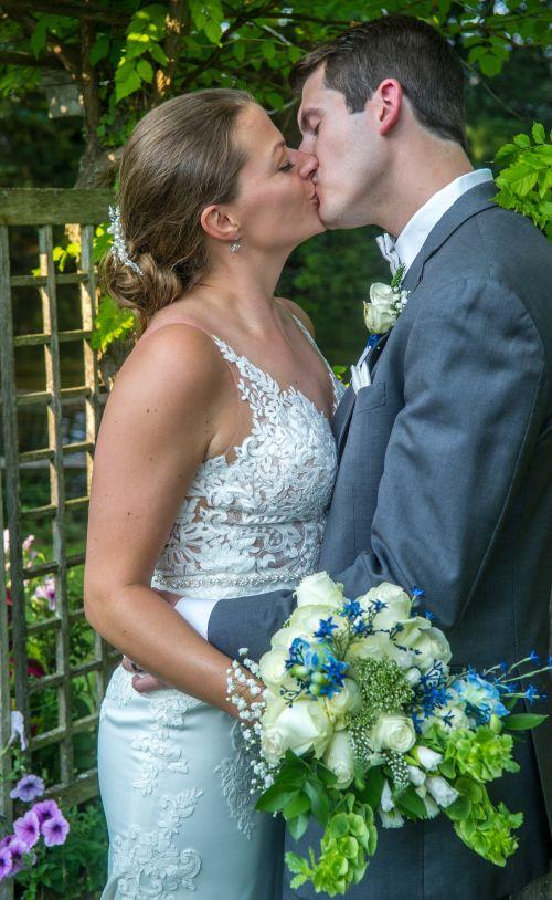 Wedding kiss mile away resteraunt courtyard marmot milford new hampshire wedding venue.  New england wedding photographer